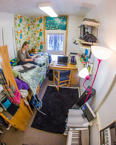 Music major Kaylie Wiltersen studies in her Skarland Hall single room.  Filename: LIF-13-3735-27.jpg