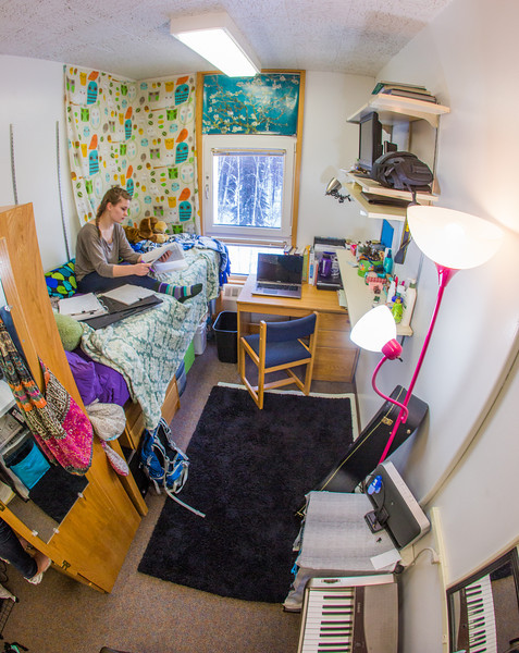 """Music major Kaylie Wiltersen studies in her Skarland Hall single room.  <div class=""""ss-paypal-button"""">Filename: LIF-13-3735-27.jpg</div><div class=""""ss-paypal-button-end"""" style=""""""""></div>"""