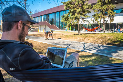 Students enjoy some spring sunshine and warm temperatures in late April on the Fairbanks campus.  Filename: LIF-16-4877-12.jpg