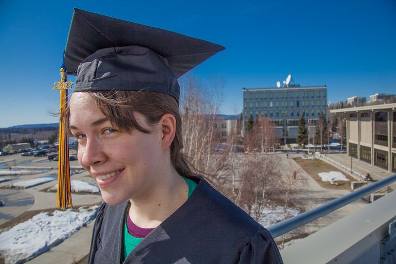 """Senior foreign languages major Lindsey Miller poses in her cap and gown on the roof of the Brooks Building on the Fairbanks campus.  <div class=""""ss-paypal-button"""">Filename: LIF-12-3352-89.jpg</div><div class=""""ss-paypal-button-end"""" style=""""""""></div>"""