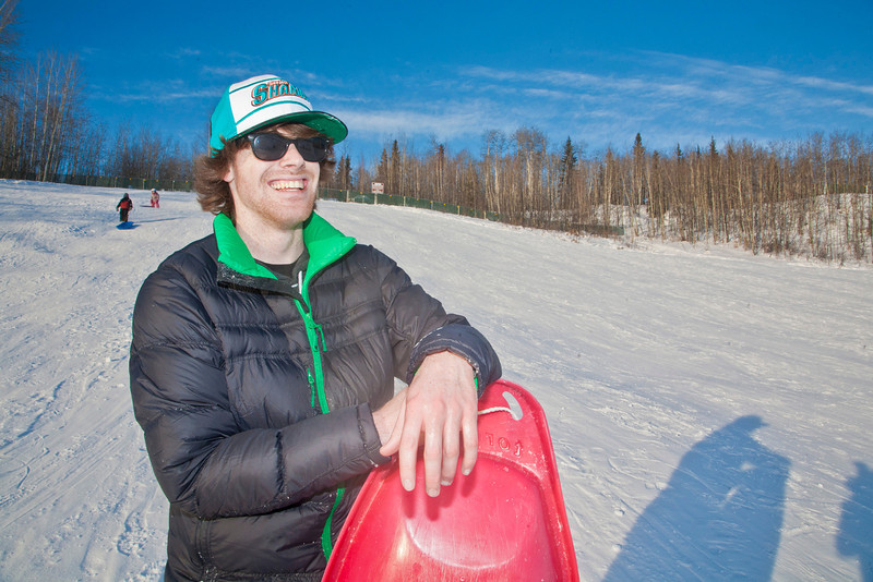 "Jimmy Donohue stops sledding for a picture on the SRC Hill on a sunny day in February.  <div class=""ss-paypal-button"">Filename: LIF-12-3289-116.jpg</div><div class=""ss-paypal-button-end"" style=""""></div>"