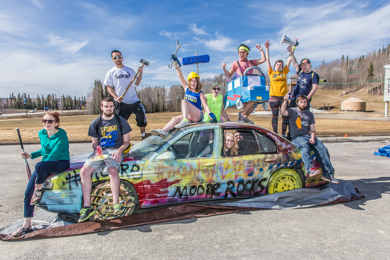"""A group of Moore Hall residents pose on a donated car before its demolished as part of UAF SpringFest April 28.  <div class=""""ss-paypal-button"""">Filename: LIF-14-4168-60.jpg</div><div class=""""ss-paypal-button-end""""></div>"""