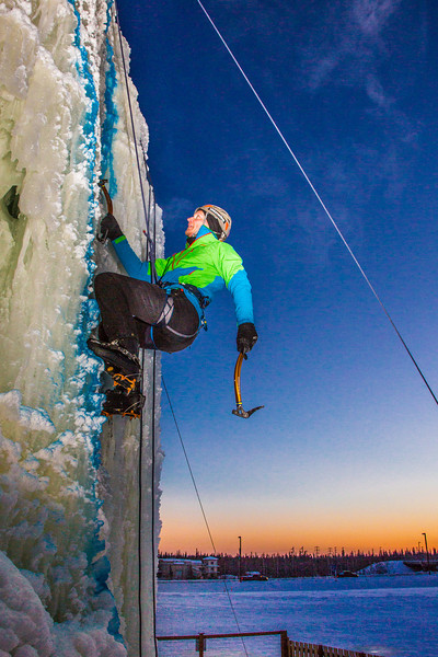 """Nick Janssen races up the tower during the ice climbing competition, offered as part of the 2014 UAF Winter Carnival.  <div class=""""ss-paypal-button"""">Filename: LIF-14-4084-17.jpg</div><div class=""""ss-paypal-button-end"""" style=""""""""></div>"""