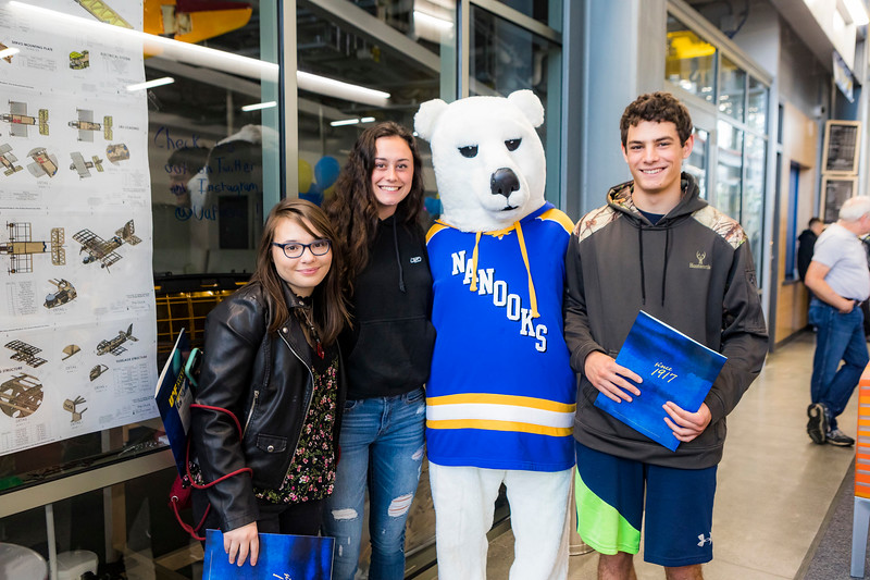 "Prospective students take a photo with Nook during the 2018 Summer Inside Out Donuts with Deans event at the Engineering Learning and Innovation Facility.  <div class=""ss-paypal-button"">Filename: LIF-18-5826-46.jpg</div><div class=""ss-paypal-button-end""></div>"