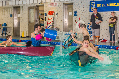 Battleship is a popular intramural sport at UAF. Teams in canoes try to swamp each other's boats during a tournament in the Patty pool.  Filename: LIF-13-3975-53.jpg