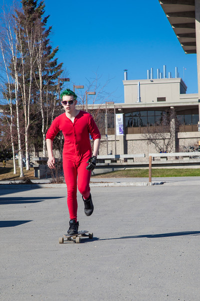 """Andrew Walsh skates around campus in his red onesie.  <div class=""""ss-paypal-button"""">Filename: LIF-12-3360-04.jpg</div><div class=""""ss-paypal-button-end"""" style=""""""""></div>"""