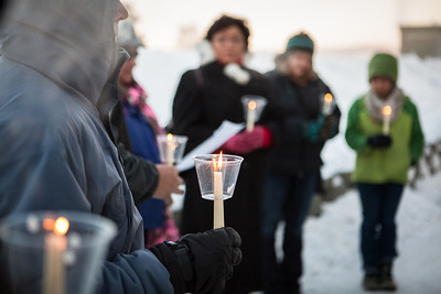 A candlelight vigil is held outside the Wood Center as part of the World Aids Day activities Saturday, Dec. 1, 2012.  Filename: LIF-12-3668-13.jpg