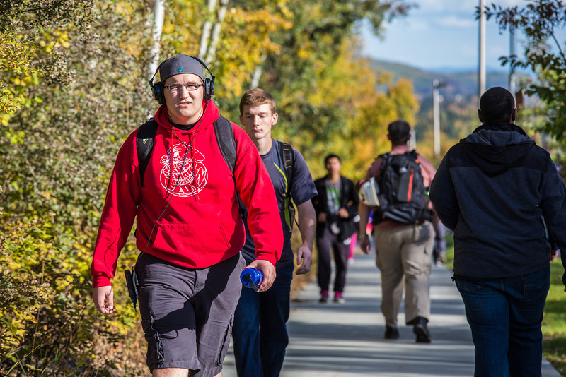 """Students make their way along Yukon Drive on a nice fall afternoon on the Fairbanks campus.  <div class=""""ss-paypal-button"""">Filename: LIF-12-3544-176.jpg</div><div class=""""ss-paypal-button-end"""" style=""""""""></div>"""
