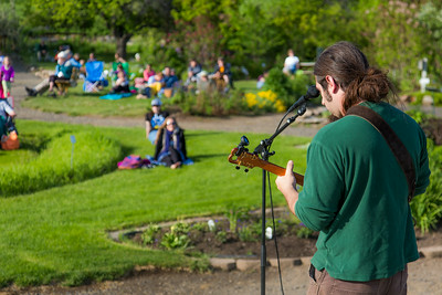 Local musician Ukulele Russ entertained a nice crowd during UAF Summer Session's free Music in the Garden concert series June 12.  Filename: LIF-14-4209-33.jpg