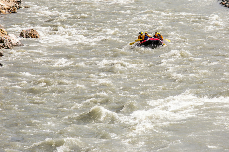 """Students and staff members navigate a stretch of white water on a raft trip down the Nenana River led by UAF Outdoor Adventures in June, 2014.  <div class=""""ss-paypal-button"""">Filename: OUT-14-4211-402.jpg</div><div class=""""ss-paypal-button-end""""></div>"""