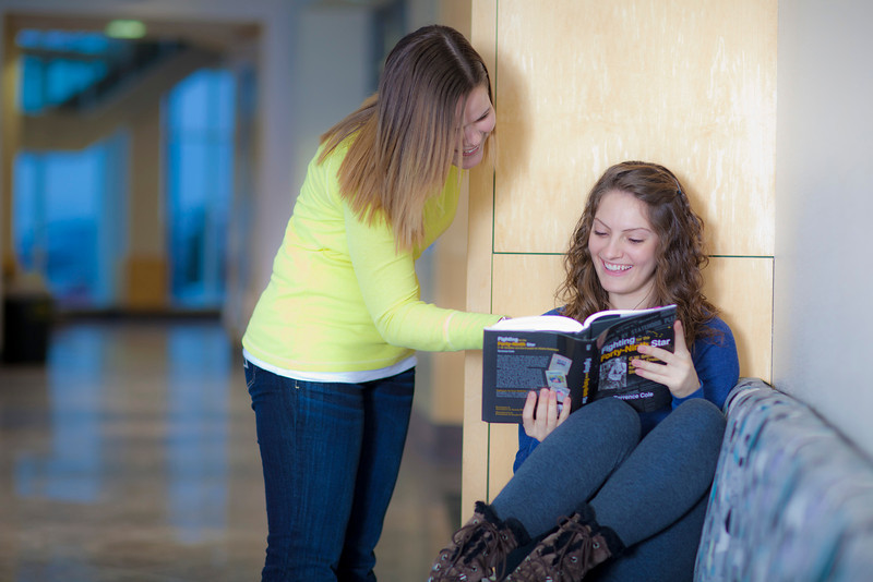 "Megan Gilmore (left) and Ashley Bartolowits (right) study in the hallway of the Syun-Ichi Akasofu building on campus.  <div class=""ss-paypal-button"">Filename: LIF-11-3242-102.jpg</div><div class=""ss-paypal-button-end"" style=""""></div>"