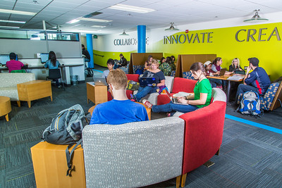 Students mingle and study in the Nook computer lounge in the Bunnell Building on the Fairbanks campus.  Filename: LIF-13-3987-11.jpg