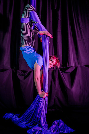 Tori Middlestadt is an active member of the silk club at UAF, in which members perform acrobatic stunts hanging from silks.  Filename: LIF-14-4133-114.jpg