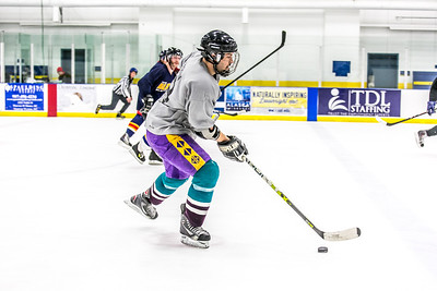 Intramural hockey action on a Tuesday night at the Patty Ice arena.  Filename: LIF-14-4111-343.jpg