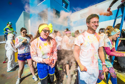 Students enjoy getting doused with colored dye before participating in a 5-kilometer run during SpringFest on the Fairbanks campus.  Filename: LIF-13-3805-80.jpg