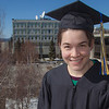 "Senior foreign languages major Lindsey Miller poses in her cap and gown on the roof of the Brooks Building on the Fairbanks campus.  <div class=""ss-paypal-button"">Filename: LIF-12-3352-2.jpg</div><div class=""ss-paypal-button-end"" style=""""></div>"