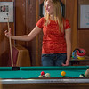 "Students unwind over a game of pool in the Wood Center Pub on the Fairbanks campus. (Note: Taken as part of commercial shoot with Nerland Agency -- use with discretion!)  <div class=""ss-paypal-button"">Filename: LIF-12-3563-018.jpg</div><div class=""ss-paypal-button-end"" style=""""></div>"
