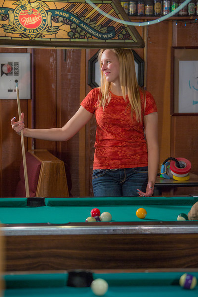 """Students unwind over a game of pool in the Wood Center Pub on the Fairbanks campus. (Note: Taken as part of commercial shoot with Nerland Agency -- use with discretion!)  <div class=""""ss-paypal-button"""">Filename: LIF-12-3563-018.jpg</div><div class=""""ss-paypal-button-end"""" style=""""""""></div>"""