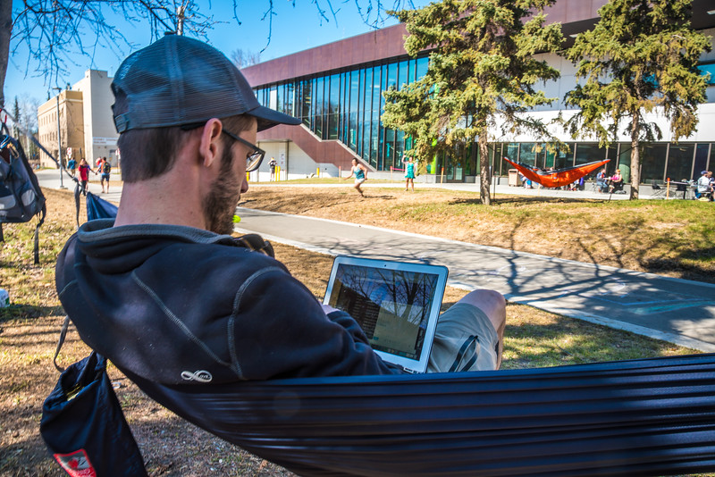 """Students enjoy some spring sunshine and warm temperatures in late April on the Fairbanks campus.  <div class=""""ss-paypal-button"""">Filename: LIF-16-4877-10.jpg</div><div class=""""ss-paypal-button-end""""></div>"""