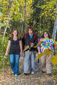 Lily Grbavach, left, Demetri Martin-Urban and Grace Amundsen, stroll through the woods near the west entrance to campus on a nice fall afternoon.  Filename: LIF-12-3544-130.jpg