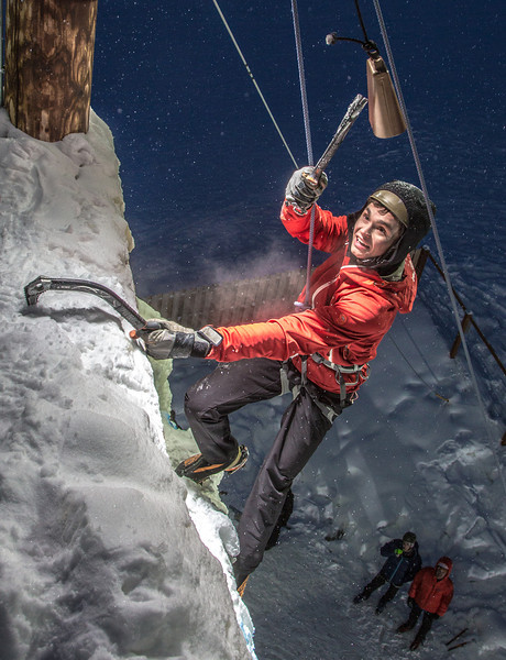 """Engineering major Ryan Cudo rings the cowbell after setting the pace with a climb up the ice wall in 20 seconds during a fun competition on March 1.  <div class=""""ss-paypal-button"""">Filename: LIF-13-3748-118.jpg</div><div class=""""ss-paypal-button-end"""" style=""""""""></div>"""