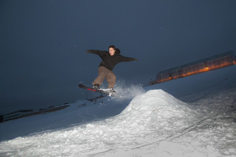 "Students take advantage of some free time during finals week to snowboard on the hill below the IAB greenhouse.  <div class=""ss-paypal-button"">Filename: LIF-11-3246-44.jpg</div><div class=""ss-paypal-button-end"" style=""""></div>"