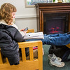 """Senior psychology/sociology major Phelicia Wazny relaxes in front of the newly installed fireplace in the Rasmuson Library.  <div class=""""ss-paypal-button"""">Filename: LIF-13-3711-12.jpg</div><div class=""""ss-paypal-button-end"""" style=""""""""></div>"""