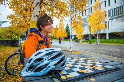 Mechanical engineering major Adam McCombs relaxes after riding his bike to campus on a fall afternoon.  Filename: LIF-12-3557-001.jpg