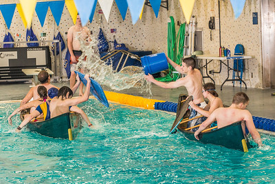 Battleship is a popular intramural sport at UAF. Teams in canoes try to swamp each other's boats during a tournament in the Patty pool.  Filename: LIF-13-3975-51.jpg