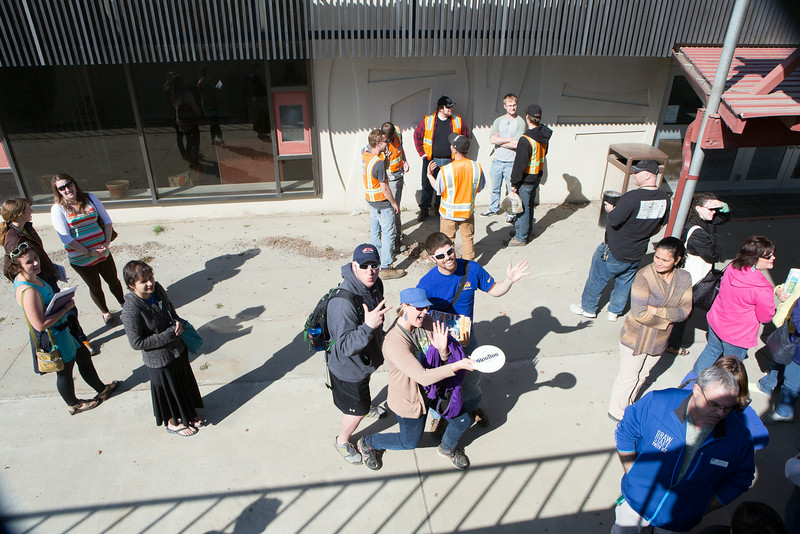 """Staff congregate at the entrance of Lola Tilly Commons before lunch during the Staff Appreciation Lunch in May.  <div class=""""ss-paypal-button"""">Filename: LIF-14-4190-13.jpg</div><div class=""""ss-paypal-button-end""""></div>"""