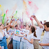 "Parade marchers throw colored pigments into the air in front of the Moore, Bartlett, Skarland dormitory during the 2012 Spring Fest Club Karneval Parade.  <div class=""ss-paypal-button"">Filename: LIF-12-3384-10.jpg</div><div class=""ss-paypal-button-end"" style=""""></div>"