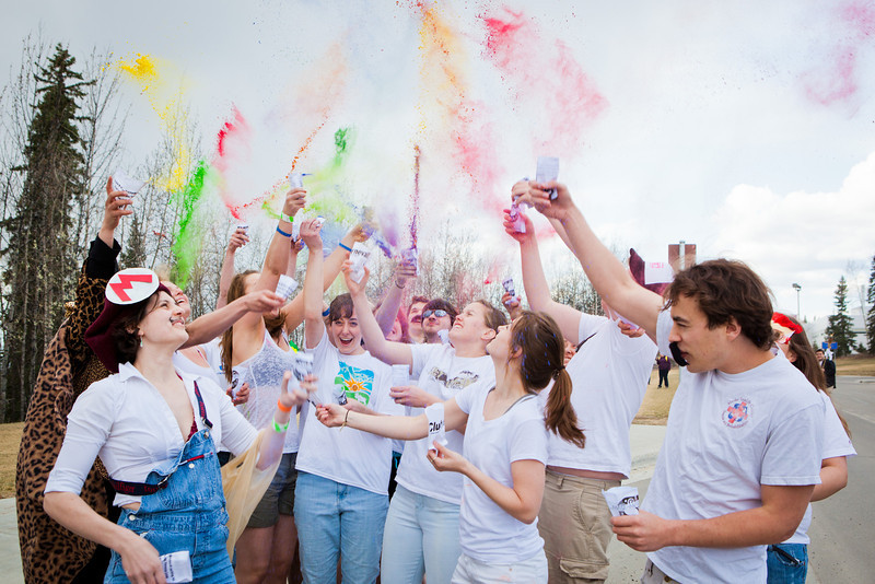 """Parade marchers throw colored pigments into the air in front of the Moore, Bartlett, Skarland dormitory during the 2012 Spring Fest Club Karneval Parade.  <div class=""""ss-paypal-button"""">Filename: LIF-12-3384-10.jpg</div><div class=""""ss-paypal-button-end"""" style=""""""""></div>"""