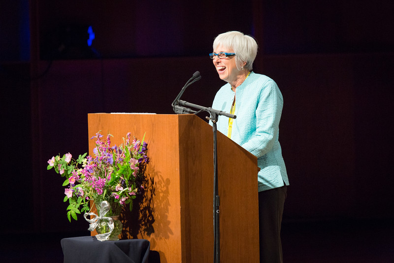 "Michelle Bartlett, director of Summer Sessions & Lifelong Learning, welcomes a packed house to a public lecture by Gloria Steinem.  <div class=""ss-paypal-button"">Filename: LIF-15-4556-51.jpg</div><div class=""ss-paypal-button-end""></div>"