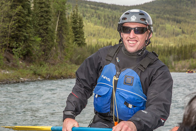 UAF Outdoor Adventures recreation manager Sam Braband leads a raft trip down the Nenana River in June, 2014.  Filename: OUT-14-4211-060.jpg
