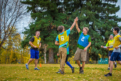Adam McCombs, #6, celebrates a score with teammates and opponents during an ultimate frisbee scrimmage on campus.  Filename: LIF-12-3557-117.jpg