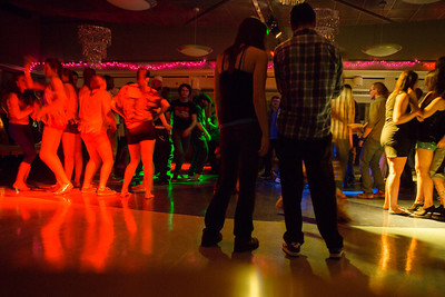 Students boogie with the music at a Mardi Gras themed dance at the Hess Rec. Center on campus.  Filename: LIF-13-3740-35.jpg