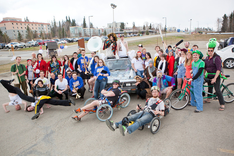 Participants of 2012 Spring Fest Club Karneval Parade pose for a group photo after the short march from Reichardt building to the Nenana Parking Lot.