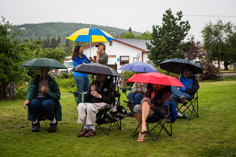 """People brave the weather with their umbrellas as they listen to music by the Opera Fairbanks Orchestra Brass at the Georgeson Botanical Garden as part of Summer Sessions' Music in the Garden series.  <div class=""""ss-paypal-button"""">Filename: LIF-13-3884-39.jpg</div><div class=""""ss-paypal-button-end"""" style=""""""""></div>"""