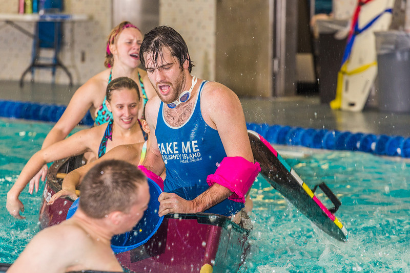 """Battleship is a popular intramural sport at UAF. Teams in canoes try to swamp each other's boats during a tournament in the Patty pool.  <div class=""""ss-paypal-button"""">Filename: LIF-13-3975-54.jpg</div><div class=""""ss-paypal-button-end"""" style=""""""""></div>"""