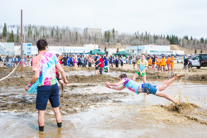 """Students take part in the mud volleyball tournament during the 2016 SpringFest on the Fairbanks campus.  <div class=""""ss-paypal-button"""">Filename: LIF-16-4879-278.jpg</div><div class=""""ss-paypal-button-end""""></div>"""
