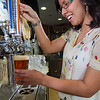 "Ida Petersen attempts to draw the perfect draft beer during her shift as a server in UAF's Wood Center Pub.  <div class=""ss-paypal-button"">Filename: LIF-11-3217-017.jpg</div><div class=""ss-paypal-button-end"" style=""""></div>"