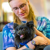 "Freshman math major Erika Blanchard takes advantage of some quality time with Penny the pomeranian during Dogs in the Library day. The event is offered during finals week to provide students with a bit of stress relief.  <div class=""ss-paypal-button"">Filename: LIF-13-4023-6.jpg</div><div class=""ss-paypal-button-end"" style=""""></div>"