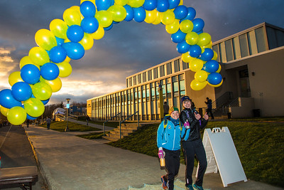 Students walk through an arch of balloons during festivities surrounding the Starvation Gulch celebration in front of the Patty Center.  Filename: LIF-12-3570-127.jpg