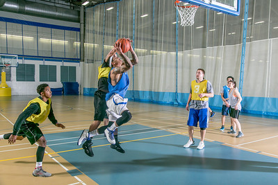 Intramural basketball action on a Tuesday night at the Student Recreation Center.  Filename: LIF-14-4111-284.jpg