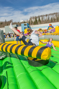 Students took turns getting  knocked around on one of the many attractions brought to campus during SpringFest Field Day on April 28.  Filename: LIF-14-4168-110.jpg