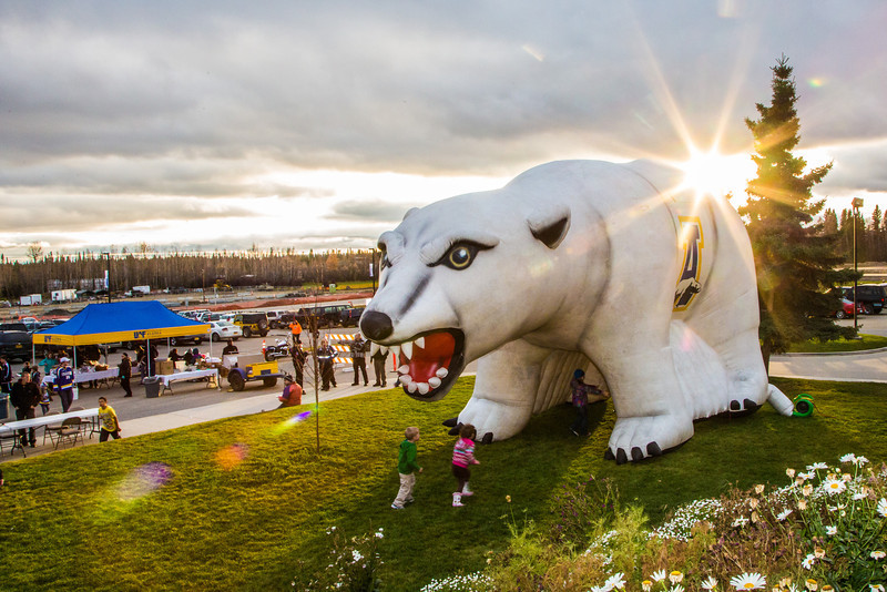 """Kids enjoy running through the inflatable Nanook set up in front of the Patty Center during Starvation Gluch weekend festivities.  <div class=""""ss-paypal-button"""">Filename: LIF-12-3570-037.jpg</div><div class=""""ss-paypal-button-end"""" style=""""""""></div>"""