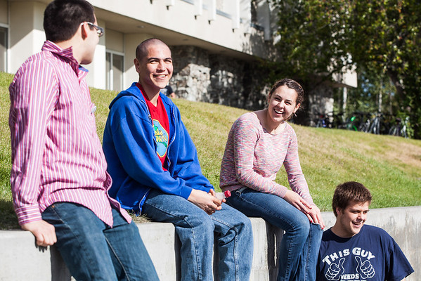 """From left: Eric Odden, Jens Irelan, Caitlin Tozier, and Kristopher Erickson socialize in the sun Tuesday, August 28, 2012 in front of the Moore, Bartlett, and Skarland dormitory complex two days before the start of the fall semester.  <div class=""""ss-paypal-button"""">Filename: LIF-12-3518-75.jpg</div><div class=""""ss-paypal-button-end"""" style=""""""""></div>"""