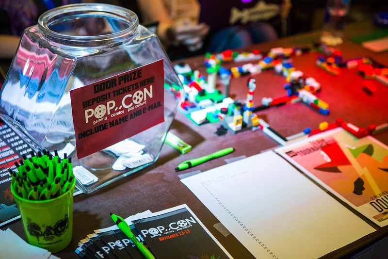 "Registration table for the 2014 PopCon in the Wood Center.  <div class=""ss-paypal-button"">Filename: LIF-14-4382-14.jpg</div><div class=""ss-paypal-button-end""></div>"