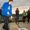 "Sergej Pucar tries his hand at a slap shot during festivities surrounding the Starvation Gulch celebration in front of the Patty Center.  <div class=""ss-paypal-button"">Filename: LIF-12-3570-053.jpg</div><div class=""ss-paypal-button-end"" style=""""></div>"