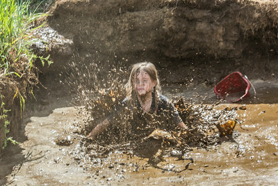 Nine-year-old Rosie Paris had a good time playing in the pit during Mud Day in the Georgeson Botanical Garden, sponsored by UAF's School of Natural Resources and Extension.  Filename: LIF-14-4212-53.jpg